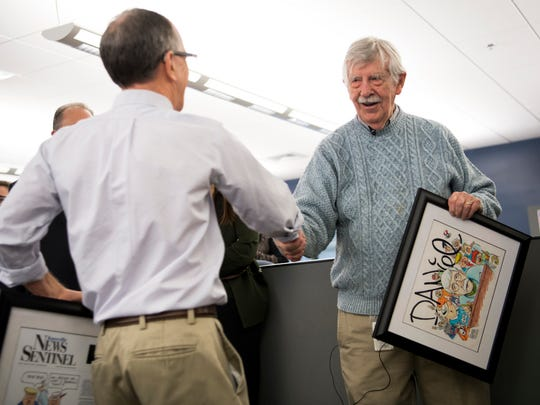 News Sentinel Executive Editor Jack McElroy gives cartoonist Charlie Daniel a handshake during a celebration for the retirements of executive editor Jack McElroy and cartoonist Charlie Daniel in the News Sentinel newsroom on Friday, February 1, 2019.