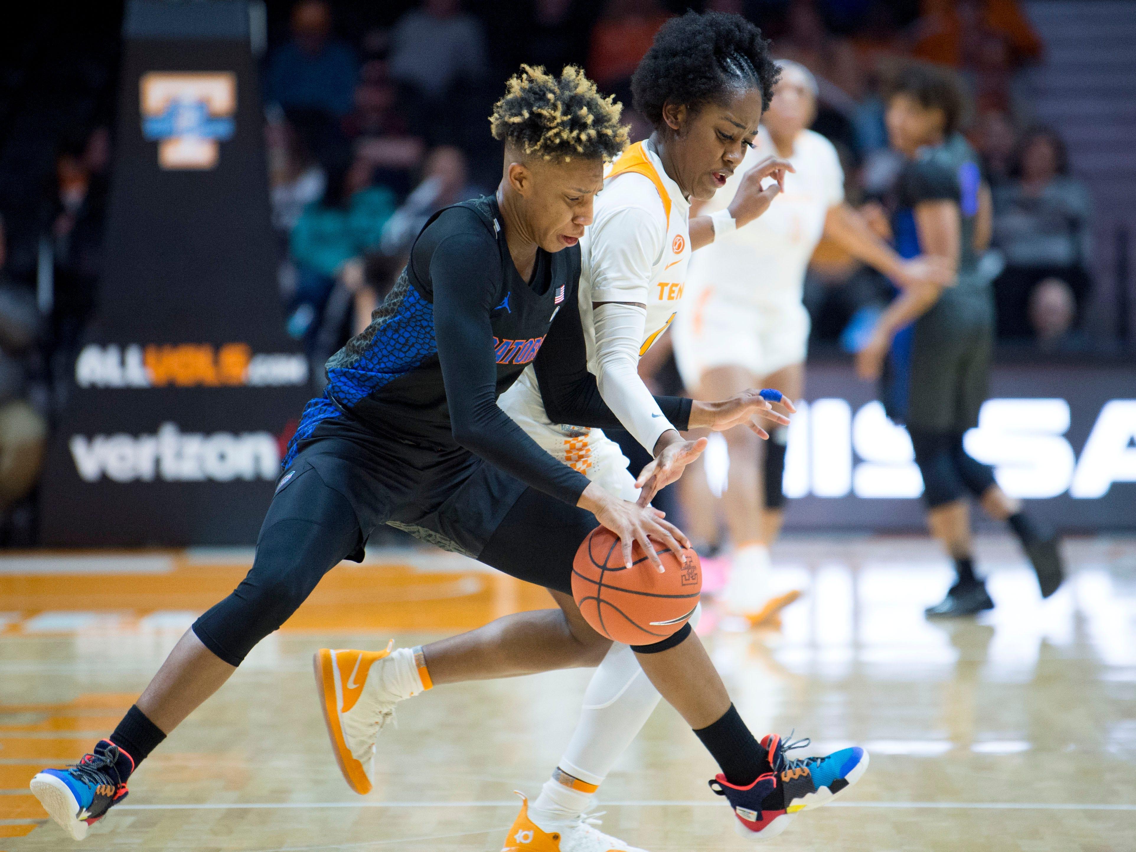 Tennessee's Zaay Green (14) guards Florida's Kiara Smith (1) on Thursday, January 31, 2019.
