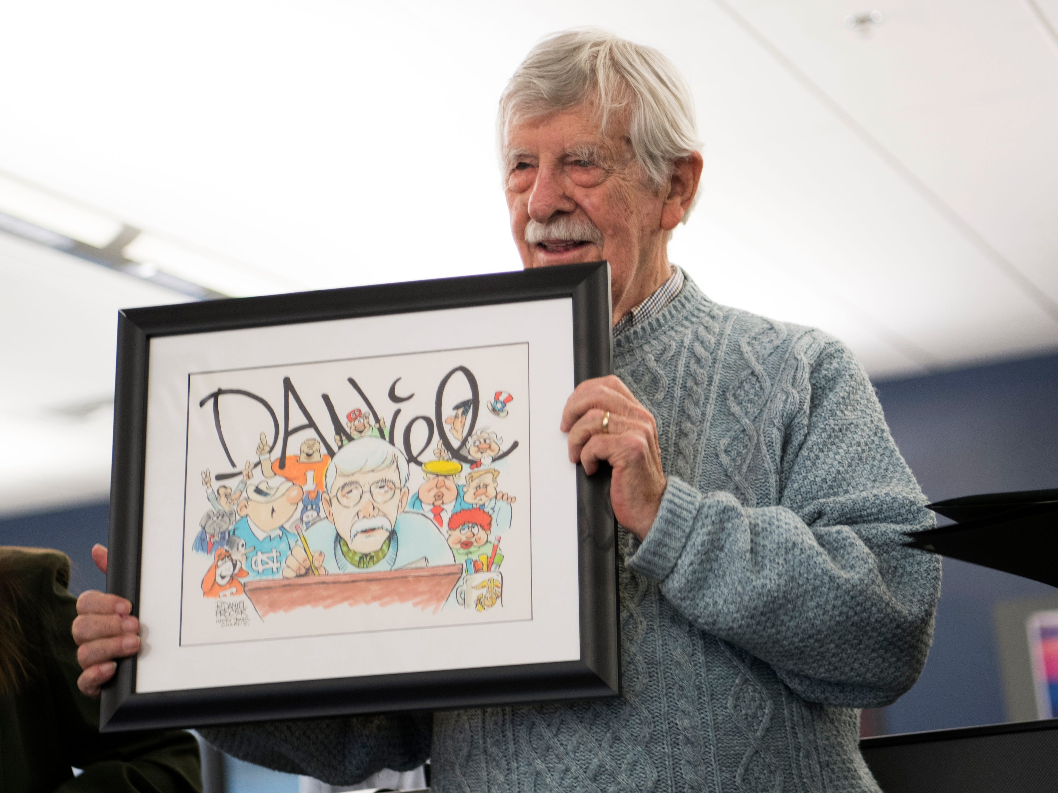News Sentinel cartoonist Charlie Daniel during a celebration of the retirements of executive editor Jack McElroy and cartoonist Charlie Daniel in the News Sentinel newsroom on Friday, February 1, 2019.