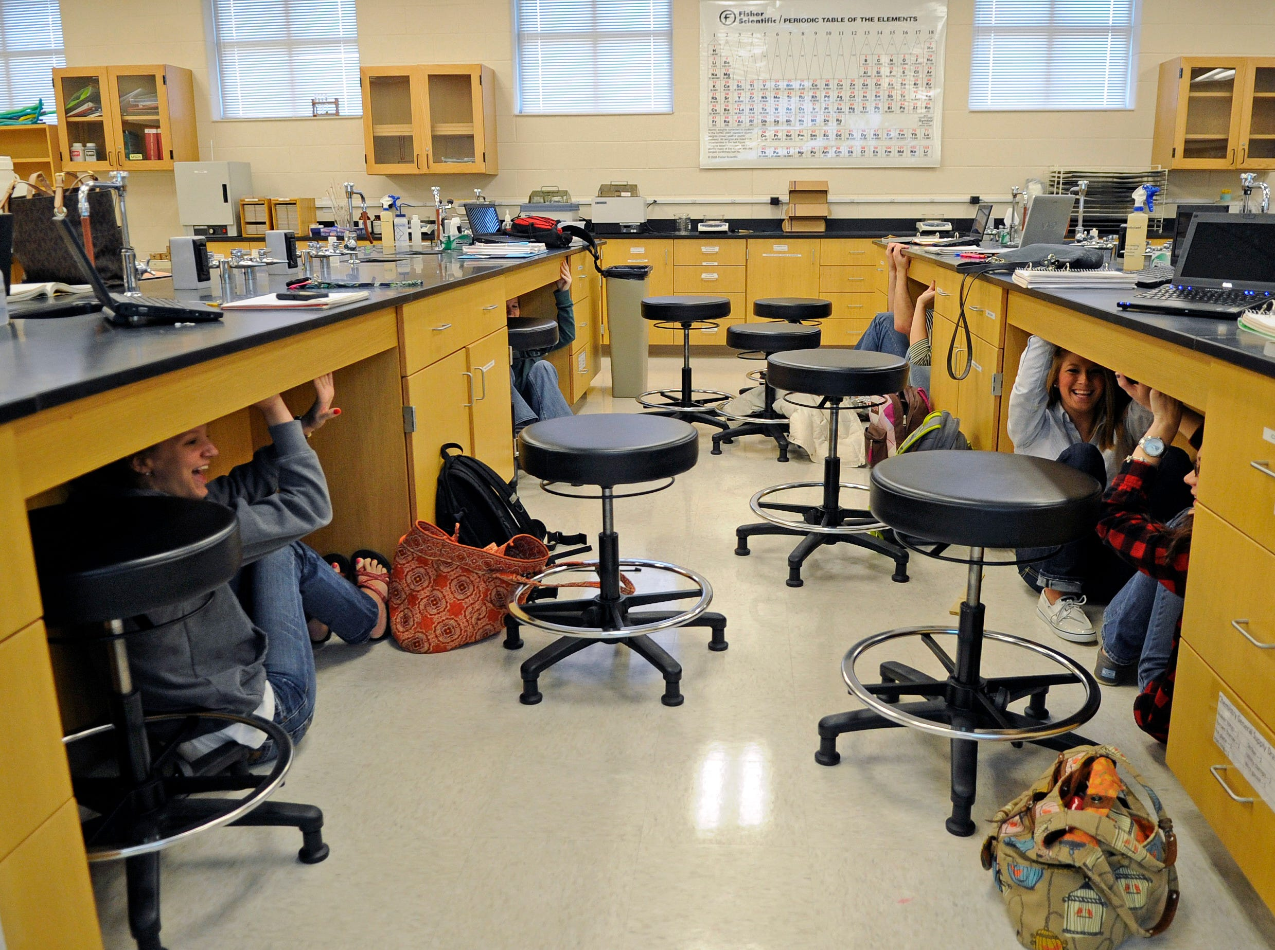 Kyla McClellan, left, Lara Nuchols and Hillary Wilson, right, participate in the Great Central U.S. ShakeOut earthquake drill during geolog class at Pellissippi State, Blount campus, on Tuesday, Feb. 7, 2012.  The drill, partially campaigned by the Tennessee Emergency Management Agency, is held across eleven states. (AMY SMOTHERMAN BURGESS/NEWS SENTINEL)