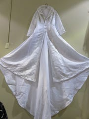 Unique wedding dress hangs on wall at Southern Belle's Closet pop-up store, which is open through February by Earth Fare in Bearden.