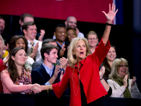 Jill Biden waves to the audience as she arrives to speak at Pellissippi State Community College, Friday, Jan. 9, 2015, in Knoxville, Tenn., about new initiatives to help more Americans go to college and get the skills they need to succeed. (AP Photo/Carolyn Kaster)