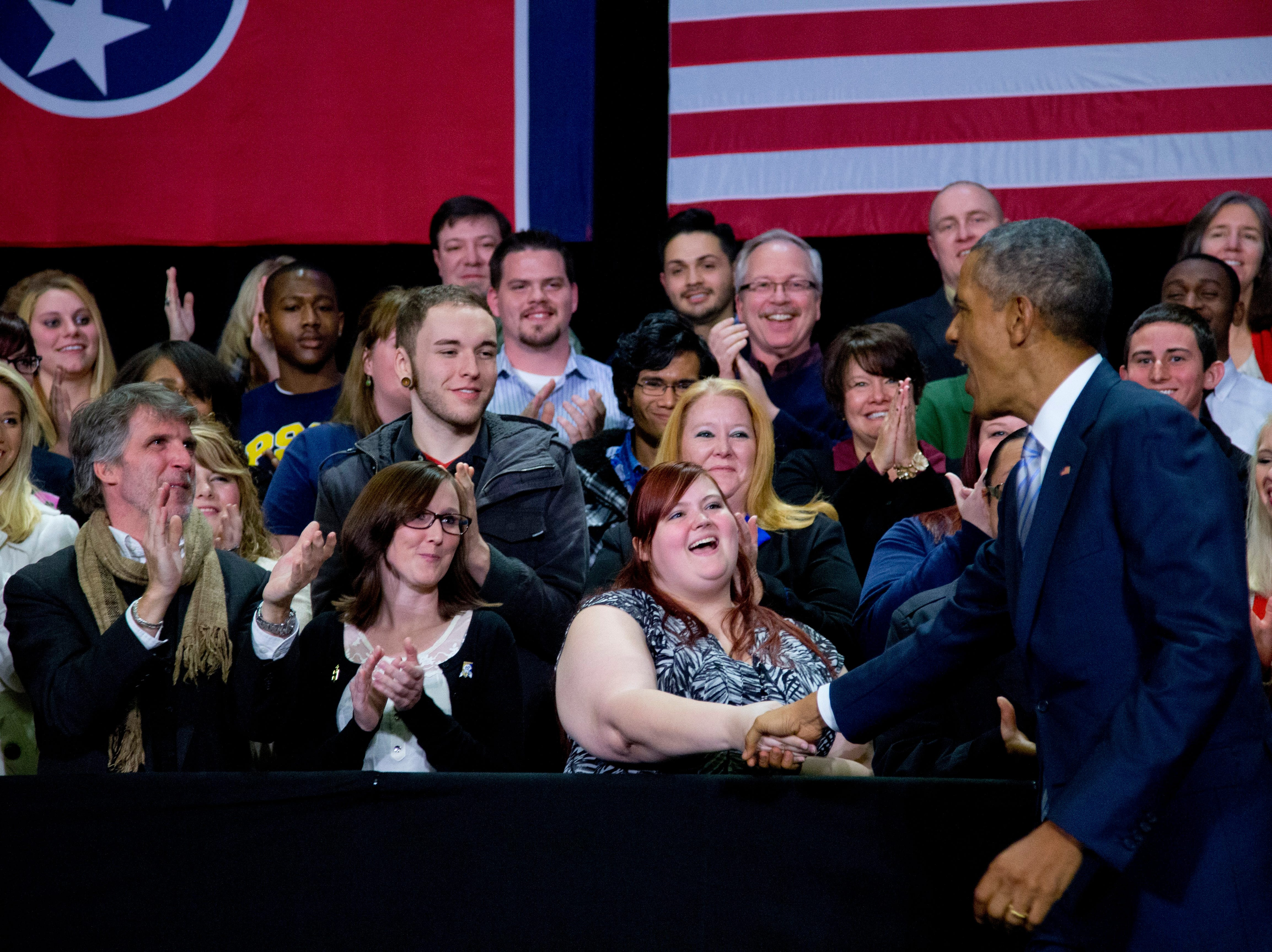 President Barack Obama greets people on stage as he arrive to speaks at Pellissippi State Community College, Friday, Jan. 9, 2015, in Knoxville, Tenn., about new initiatives to help more Americans go to college and get the skills they need to succeed. (AP Photo/Carolyn Kaster)