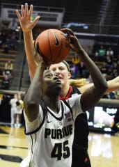 Scenes from Thursday's battle between the Purdue women and Nebraska. Fatou Diagne.