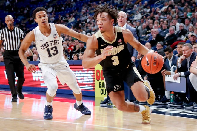 Purdue's Carsen Edwards (3) drives past Penn State's Rasir Bolton (13) during the first half of an NCAA basketball game, Thursday, Jan. 31, 2019, in University Park, Pa.