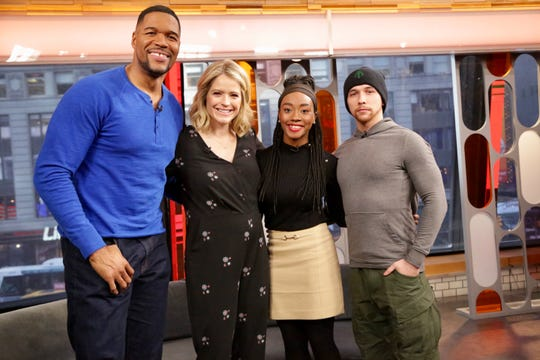 "Antonia Bundy, third from left, a Lafayette police dispatcher, appeared this week on ABC's ""Strahan and Sara"" after the help she offered to a Lafayette boy who called 911 for help with his homework struggles. Here, she poses with hosts Michael Strahan and Sara Haines, and her husband, Broady Bundy."