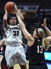 Junior Ae'Rianna Harris gets a jumper off inside over Ashtyn Veerbeek as the Boilermakers battle Nebraska Thursday night at Mackey Arena.