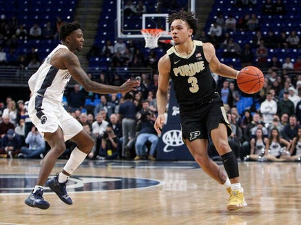 Jan 31, 2019; University Park, PA, USA; Purdue Boilermakers guard Carsen Edwards (3) dribbles the ball as Penn State Nittany Lions guard Jamari Wheeler (5) defends during overtime at Bryce Jordan Center. Purdue defeated Penn State 99-90 in overtime.Mandatory Credit: Matthew O'Haren-USA TODAY Sports
