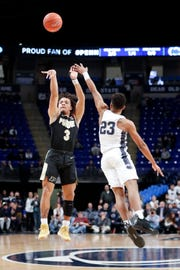 Purdue's Carsen Edwards (3) shoots a 3-pointer as Penn State's Josh Reaves (23) defends during the first half of an NCAA college basketball game Thursday, Jan. 31, 2019, in State College, Pa.