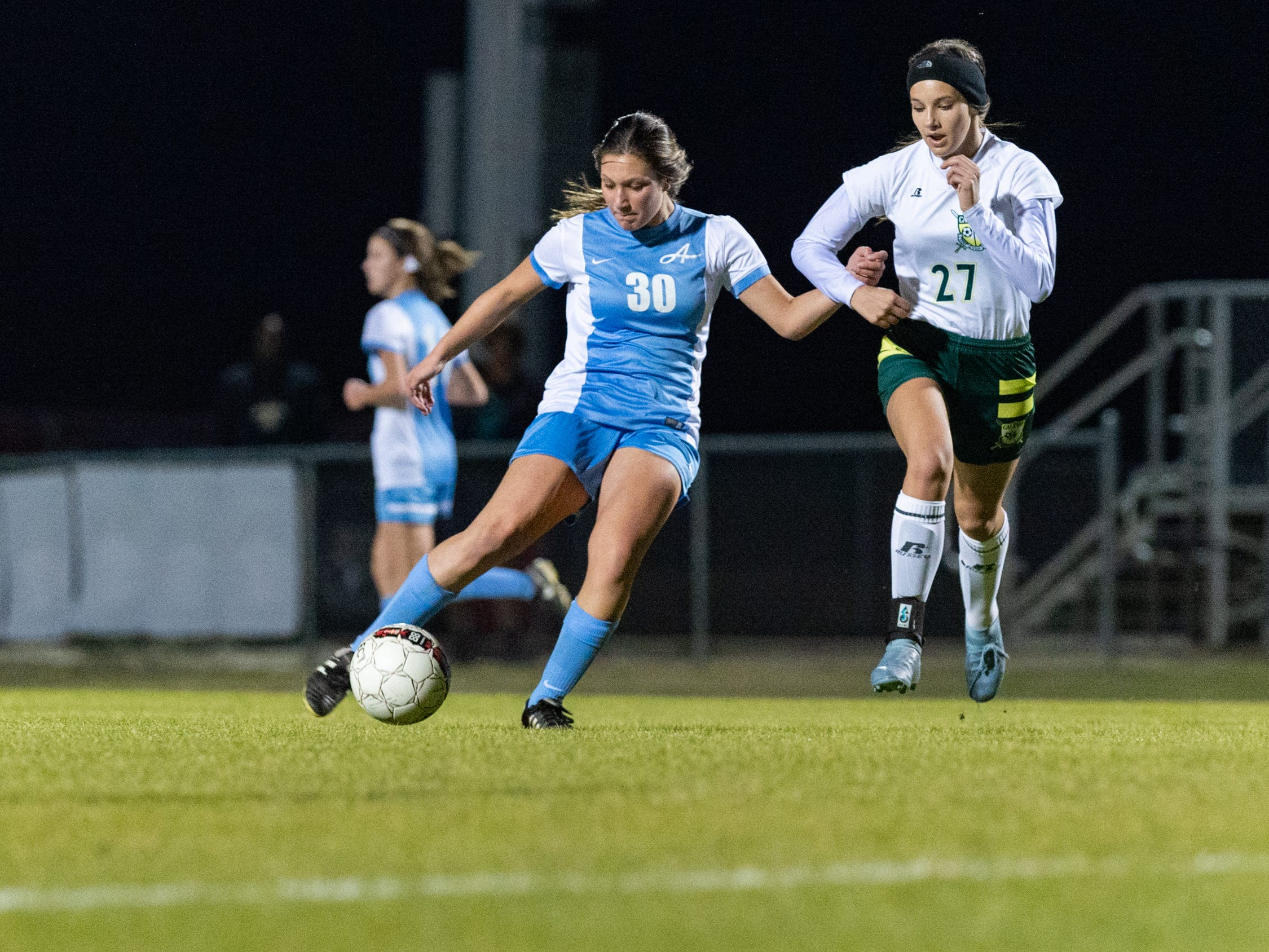 Camille Blanchard takes a shot as the Ascension Blue Gators blank the Calvary Cavaliers 6-0. Thursday, Jan. 31, 2019.