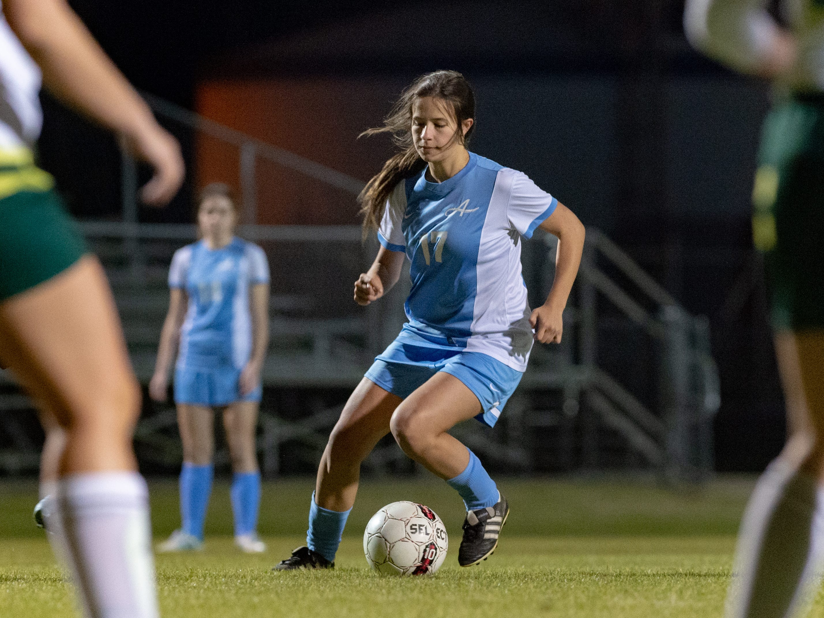 Anna-Kathryn Charboni moves the ball as the Ascension Blue Gators blank the Calvary Cavaliers 6-0. Thursday, Jan. 31, 2019.