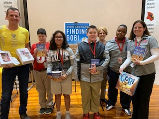 Author Dion Leonard, left, visited students at Judice Middle.