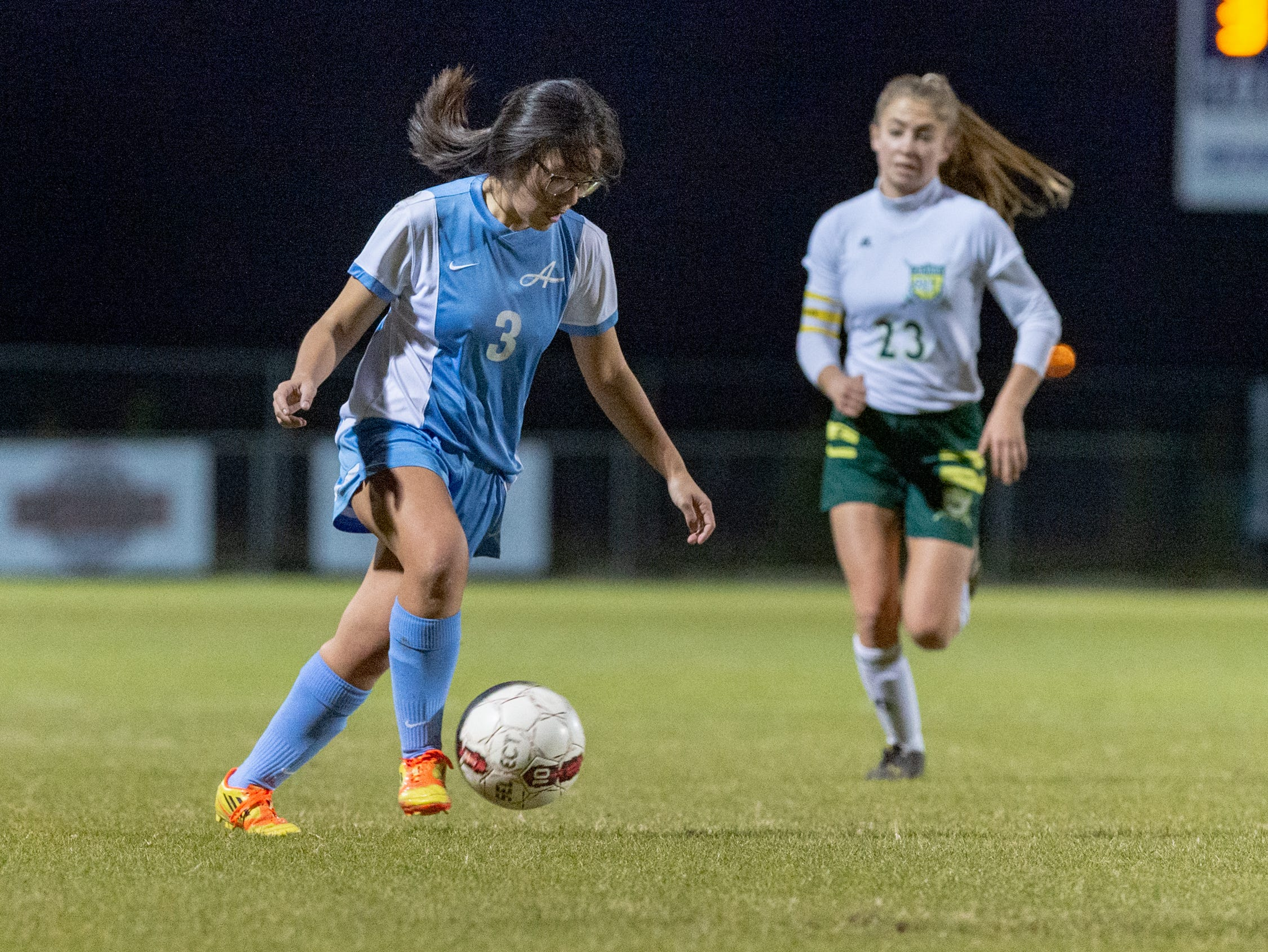 Grace Loos moves the ball as the Ascension Blue Gators blank the Calvary Cavaliers 6-0. Thursday, Jan. 31, 2019.