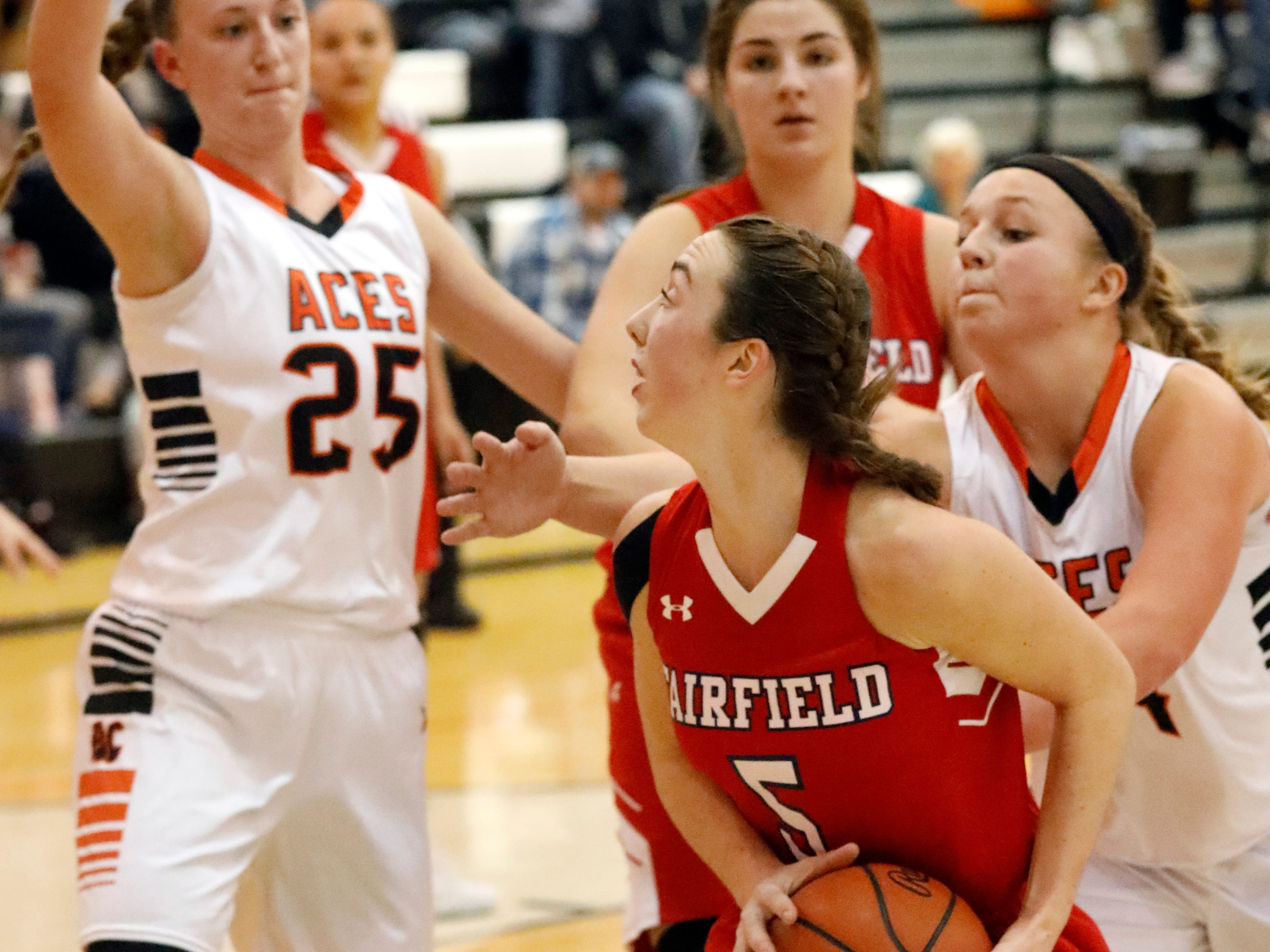 Fairfield Christian's Hope Custer tries to drive through the Amanda-Clearcreek defense during Thursday night's game, Jan. 31, 2019, at Amanda-Clearcreek High School in Amanda. The Aces won the game 51-43.