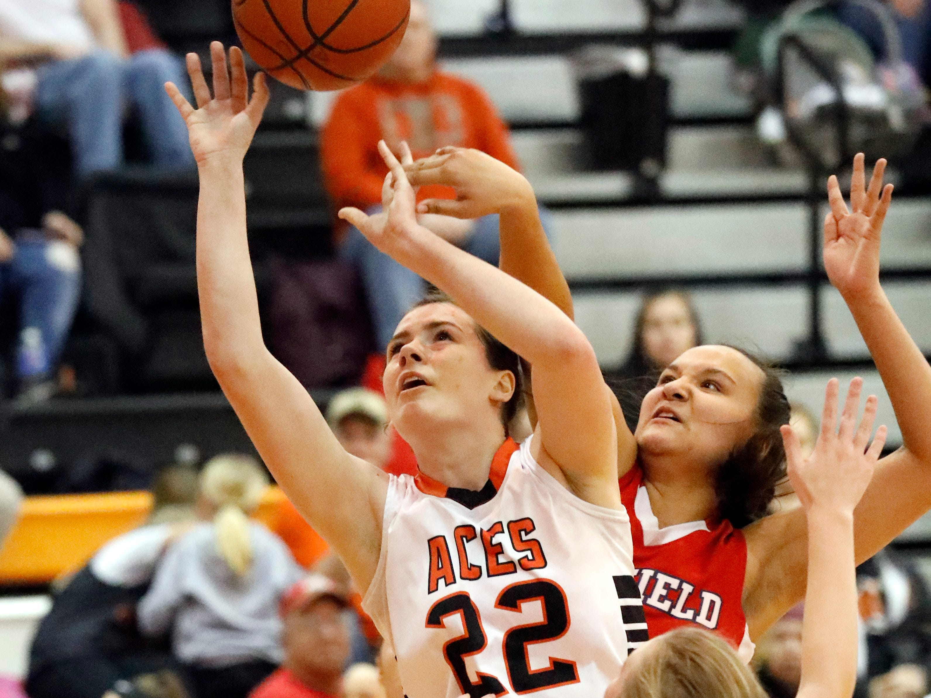Amanda-Clearcreek's Katelynn Connell is fouled by Fairfield Christian's Janae Grabans during Thursday night's game, Jan. 31, 2019, at Amanda-Clearcreek High School in Amanda. The Aces won the game 51-43.