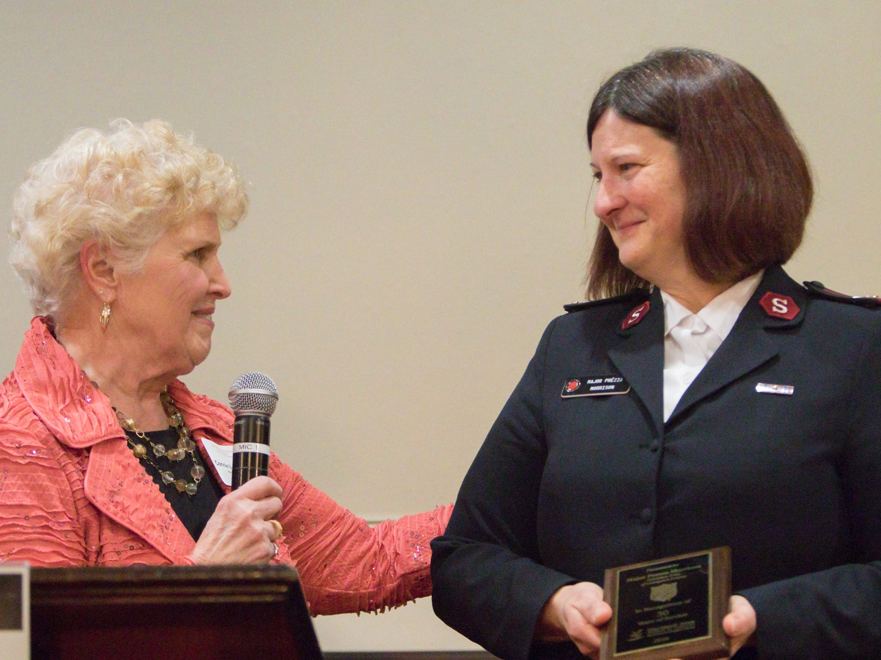 Hartland Chamber past president Connie Brinkerhoff congratulates Maj. Prezza Morrison of the Salvation Army for 30 years of service to the community at the chamber's awards dinner Thursday, Jan. 31, 2019.