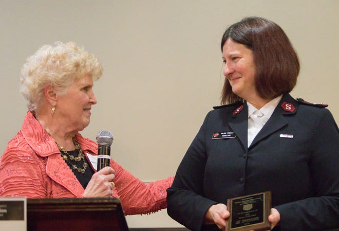 Hartland Chamber Past-President Connie Brinkerhoff congratulates Major Prezza Morrison of the Salvation Army for 30 years of community service at the chamber's awards dinner Thursday, Jan. 31, 2019.