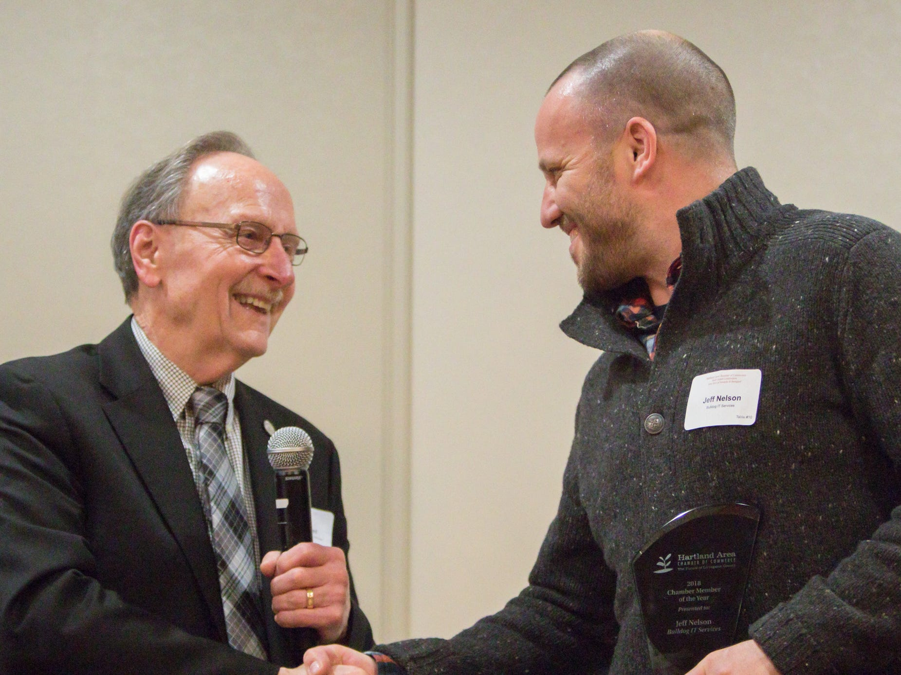 Rep. Hank Vaupel, left, congratulates Jeff Nelson of Bulldog IT Services for receiving the Chamber Member of the Year award at the chamber dinner Thursday, Jan. 31, 2019.
