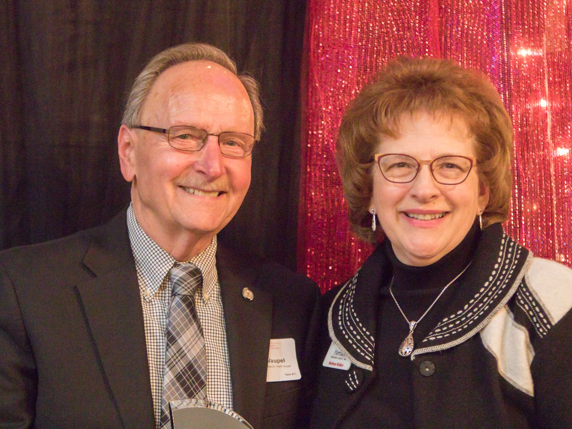 Rep. Hank Vaupel is honored with Business Advocate of the Year award by Hartland Chamber board director Barbara Walker at the chamber's awards dinner Thursday, Jan. 31, 2019.
