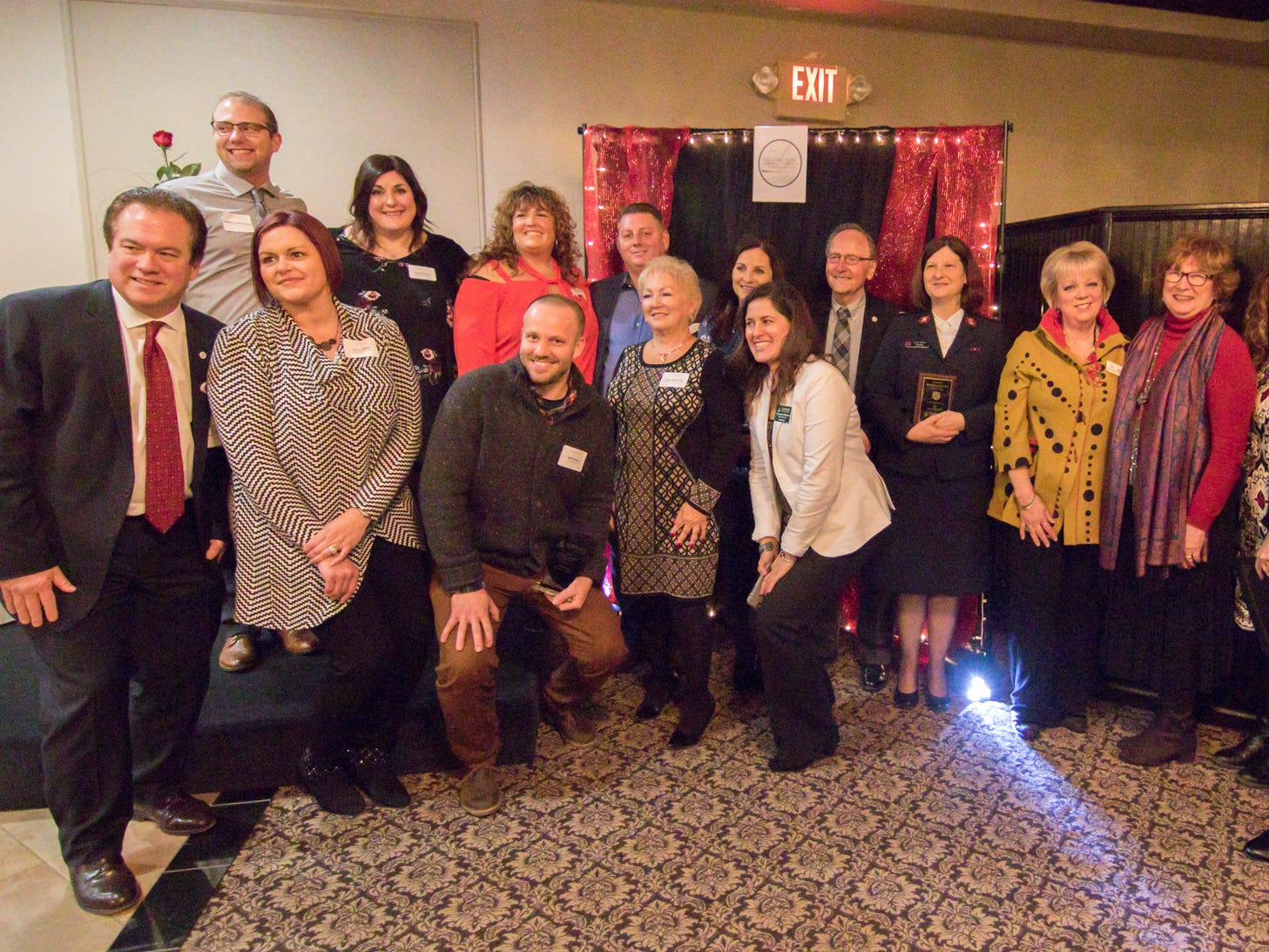 Honorees including Susan Alderson, R.N., eighth from the left, of Fountain of Youth Skin Renewal Centre which was given the Business Excellence award, pose at the end of the Hartland Chamber awards dinner Thursday, Jan. 31, 2019.