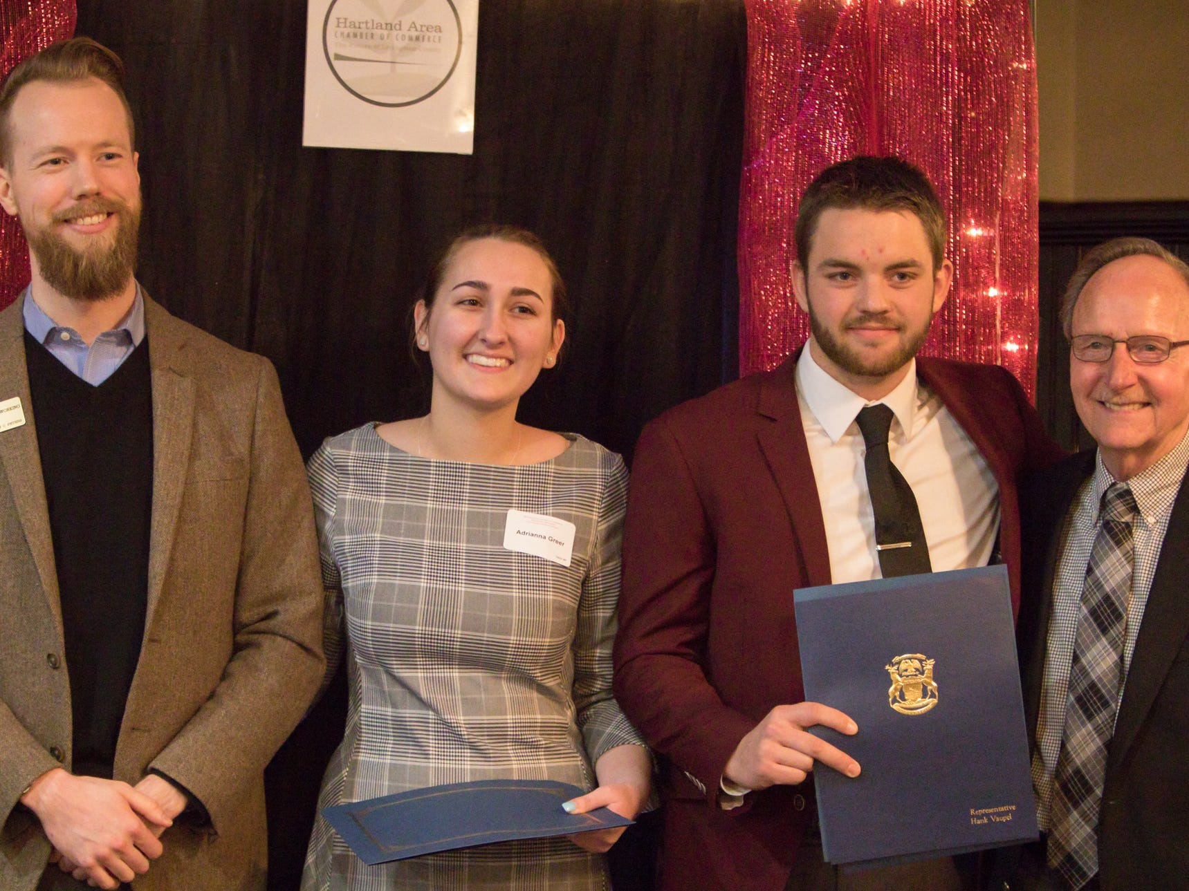 Griffin Working from U.S. Sen. Gary Peters' office, at left, and Rep. Hank Vaupel, right, present recognition to scholarship recipients Adrianna Greer and Griffin Neuer at the Hartland Chamber awards dinner Thursday, Jan. 31, 2019.