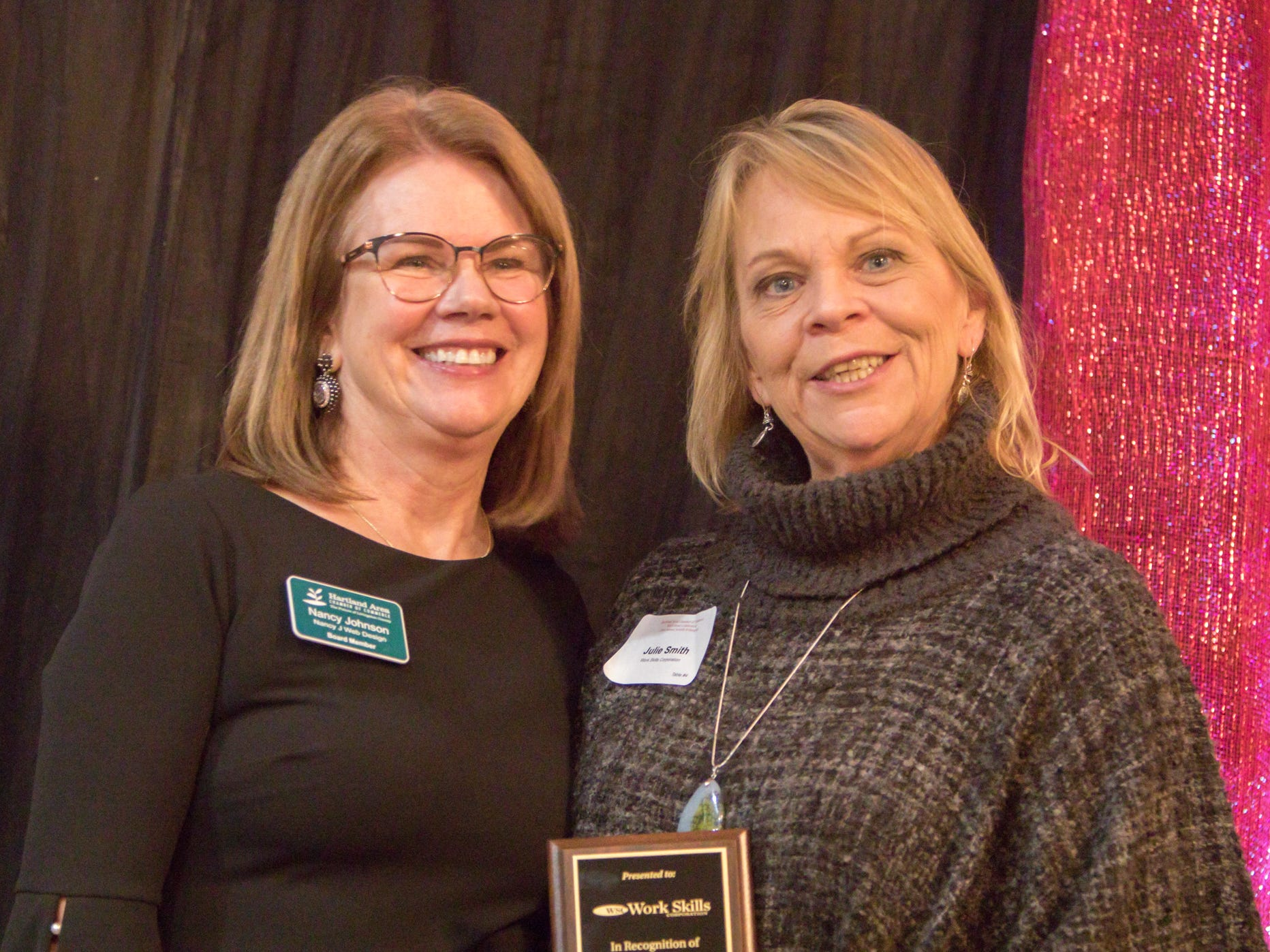 Hartland Chamber board director Nancy Johnson, left, presents Julie Smith, development manager for Work Skills Foundation, with a plaque for 45 years of service at the chamber's awards dinner Thursday, Jan. 31, 2019.