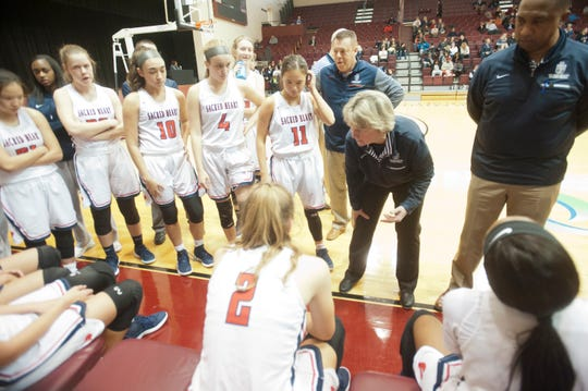 Sacred Heart head basketball coach Donna Moir talks to her players during a time-out in the Girls Louisville Invitational Tournament. Jan. 31, 2019