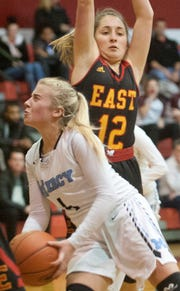 Mercy guard Hope Sivori drives to the basket being defended by Bullit East guard Sarah Ezell in the Girls Louisville Invitational Tournament.31 January 2019