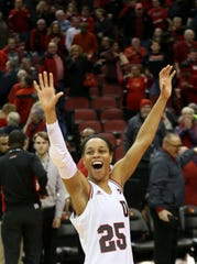 Louisville's Asia Durr celebrates after the Cards defeat UConn.  Jan. 31, 2019