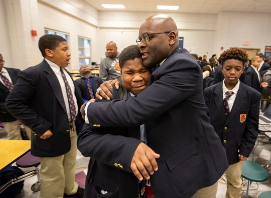 "Tyler Johnson, left, is surprised by Damon Smith's hug during the ""Sharing Love"" session before classes began at the W.E.B. DuBois Academy. Smith is a security officer for the school. Feb. 1, 2019."