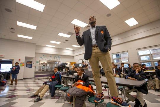 W.E.B. DuBois Acadmey principal Robert Gunn Jr. addresses students in the caeteria before classes begin. Feb. 1, 2019