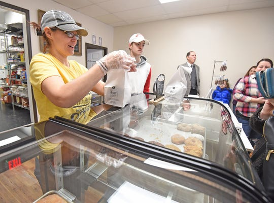 Jessica Carver packages up sweet treats at her new bakery Sweet Dreams in Shelby.