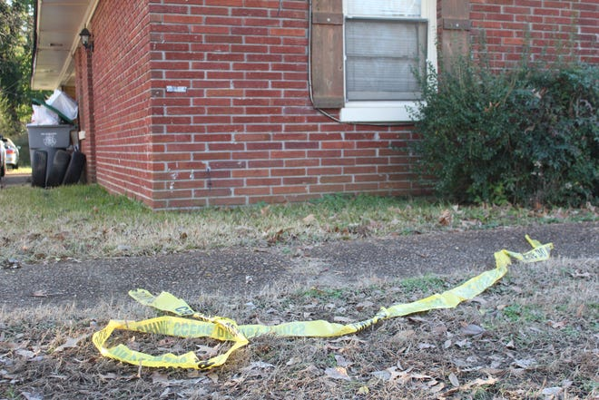 Crime scene tape leftover  in the yard outside of the home where Abdoulaye Thiam was fatally shot by Memphis Police officers.