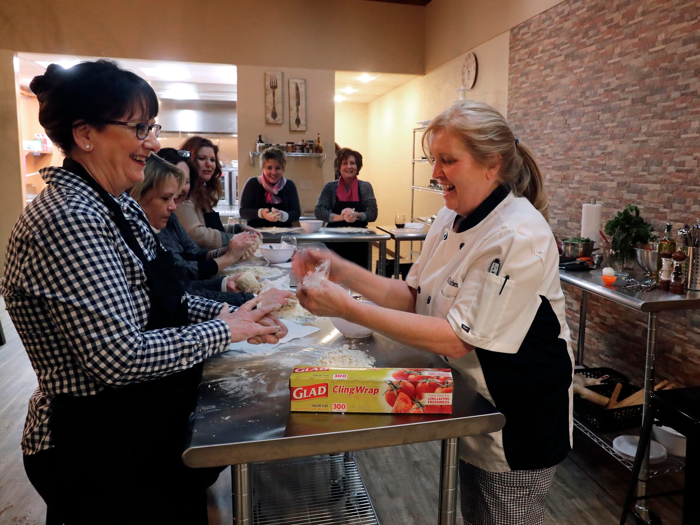Pam Dennis prepares to wrap the dough created by student Marty Gibson.