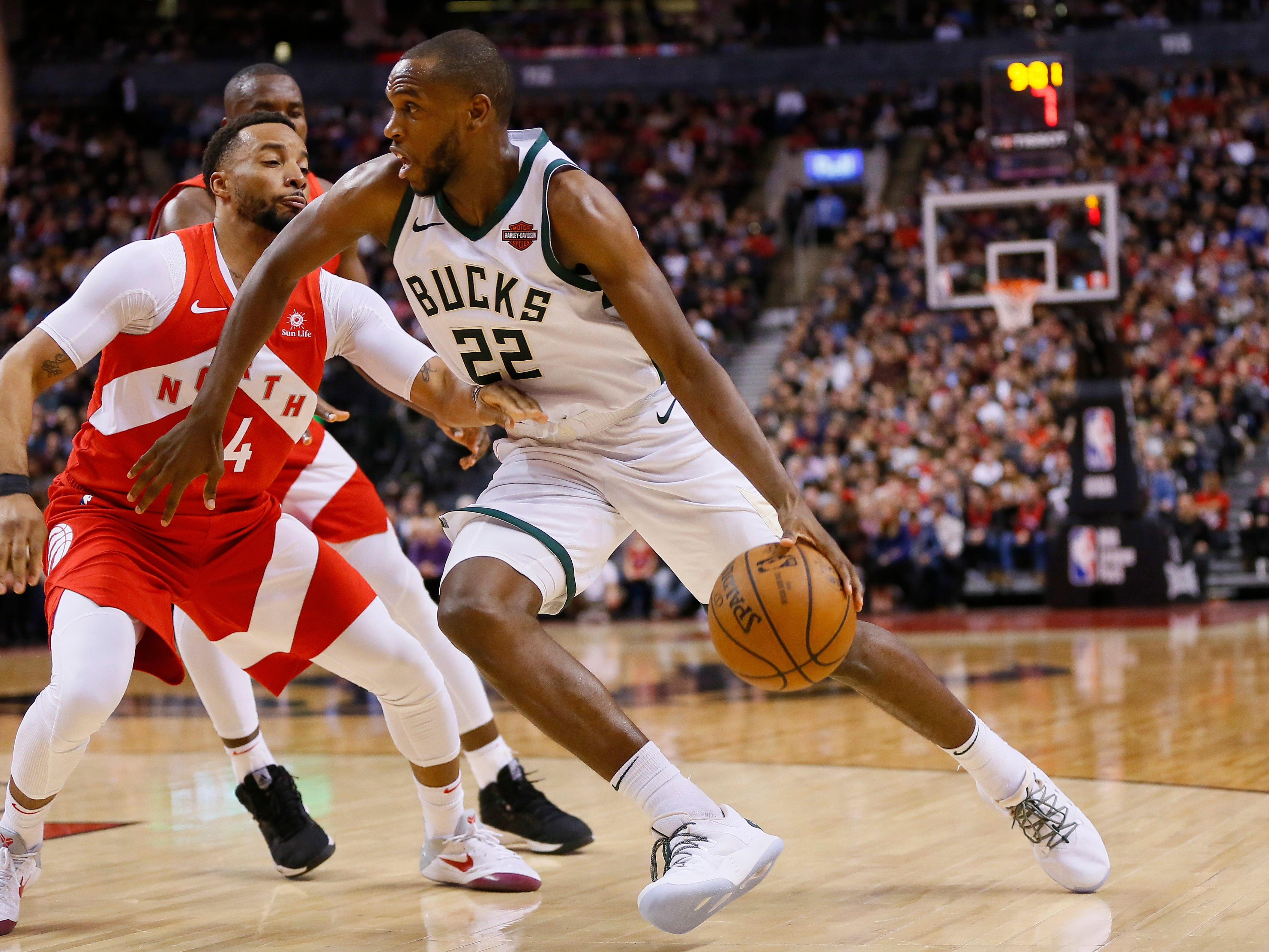 Bucks forward Khris Middleton, who finished with 18 points Thursday night, drives past Raptors guard Norman Powell during the second half.