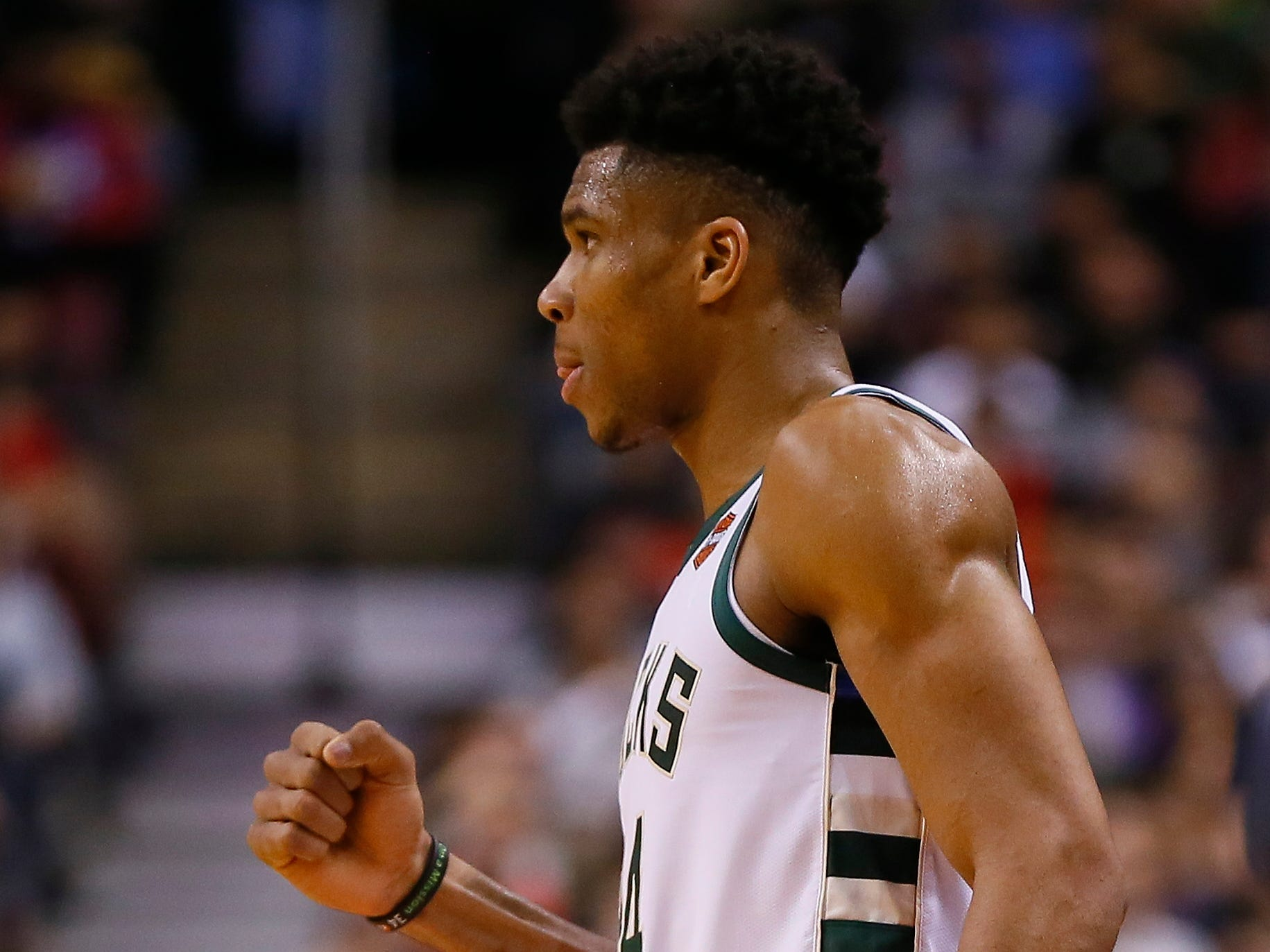 Giannis Antetokounmpo gives it a first pump after a play late in the Bucks' victory over the host Raptors on Thursday night.