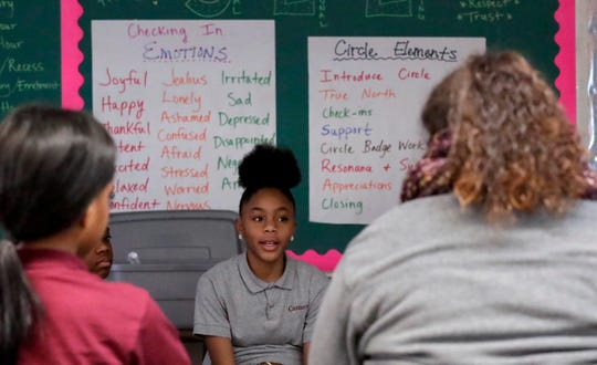 JaNya Johnson describes her emotions during the advisory circle at Carmen Northwest Middle-High School of Science and Technology Northwest.