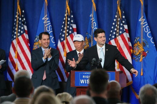 In November 2017, then-Gov. Scott Walker (left), Foxconn Chairman Terry Gou, and then-U.S. Congressman Paul Ryan applauded an agreement for the Taiwanese electronics manufacturer to build a massive manufacturing campus in Wisconsin. In the past week, uncertainties emerged over the feasibility of the project, which relies on $4 billion in state and local subsidies.