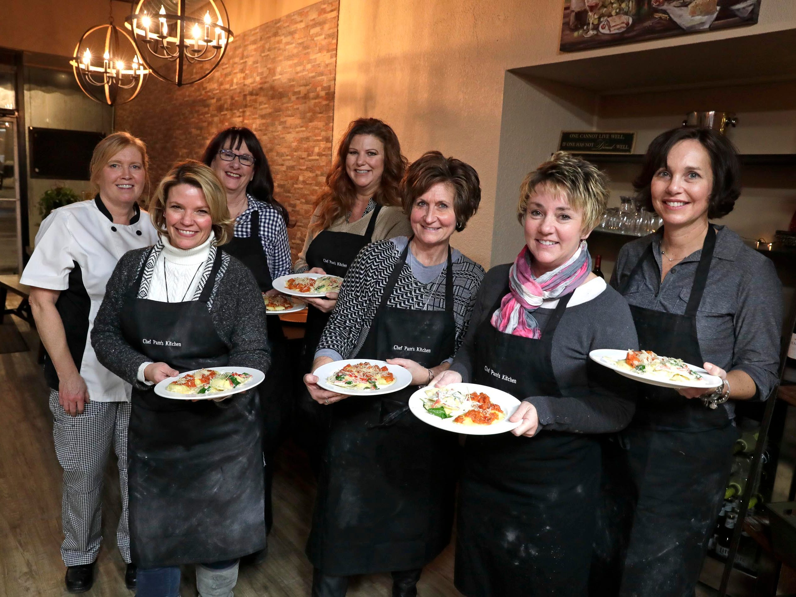 Class is finished! From left: chef-instructor Pam Dennis, Wendy Minor, Marty Gibson, Chris Liedtke, Kim Perreault, Lori Cieslik and Beth Zeiler.