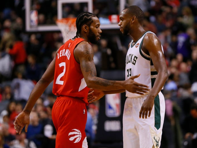 A pair of all-star forwards in the Raptors' Kawhi Leonard and the Bucks' Khris Middleton exchange pleasantries after Milwaukee's 105-92 victory on Thursday night in Toronto.