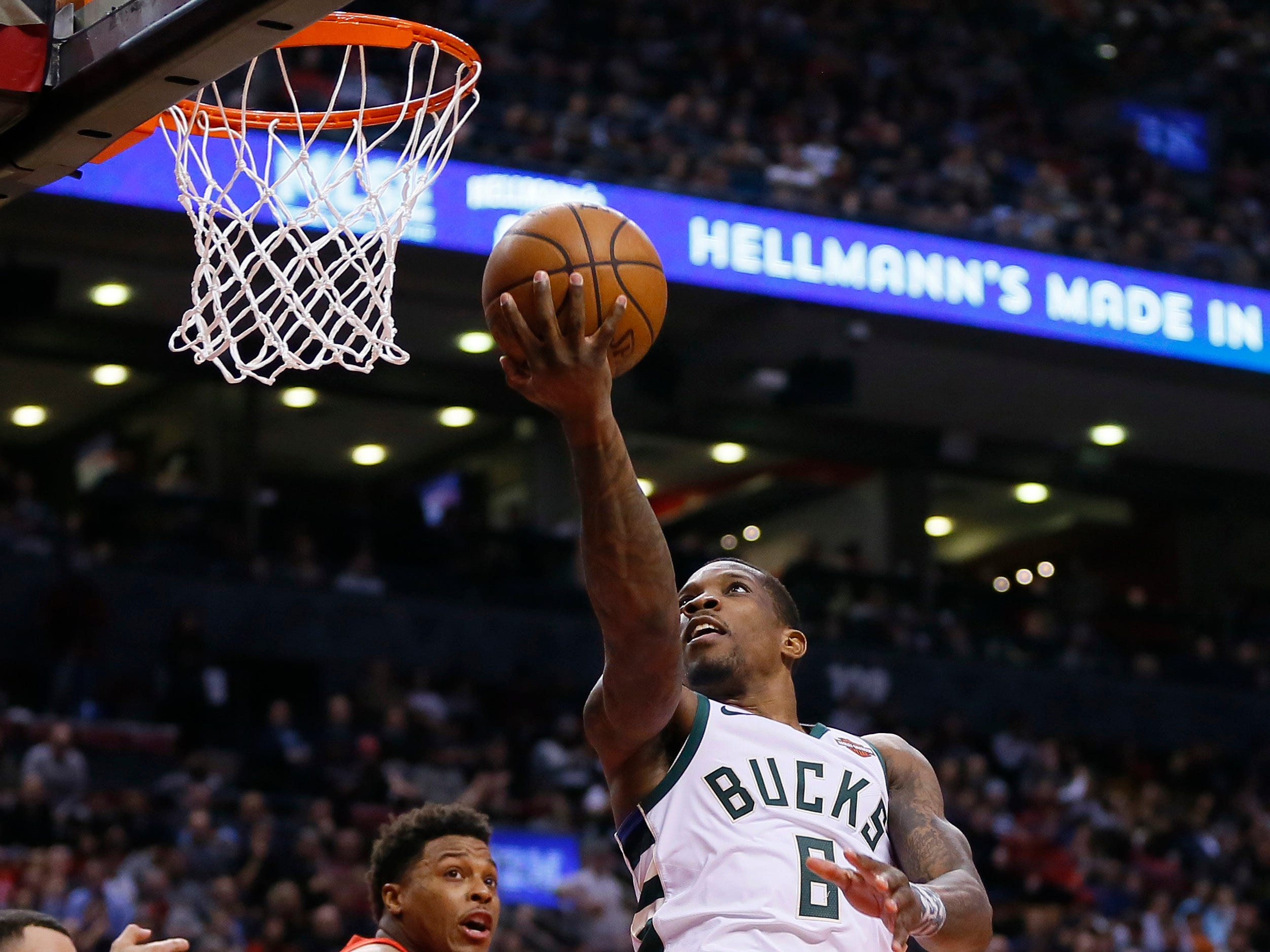 Bucks guard Eric Bledsoe goes up for a layup after getting past Raptors guard Kyle Lowry during the second half Thursday.