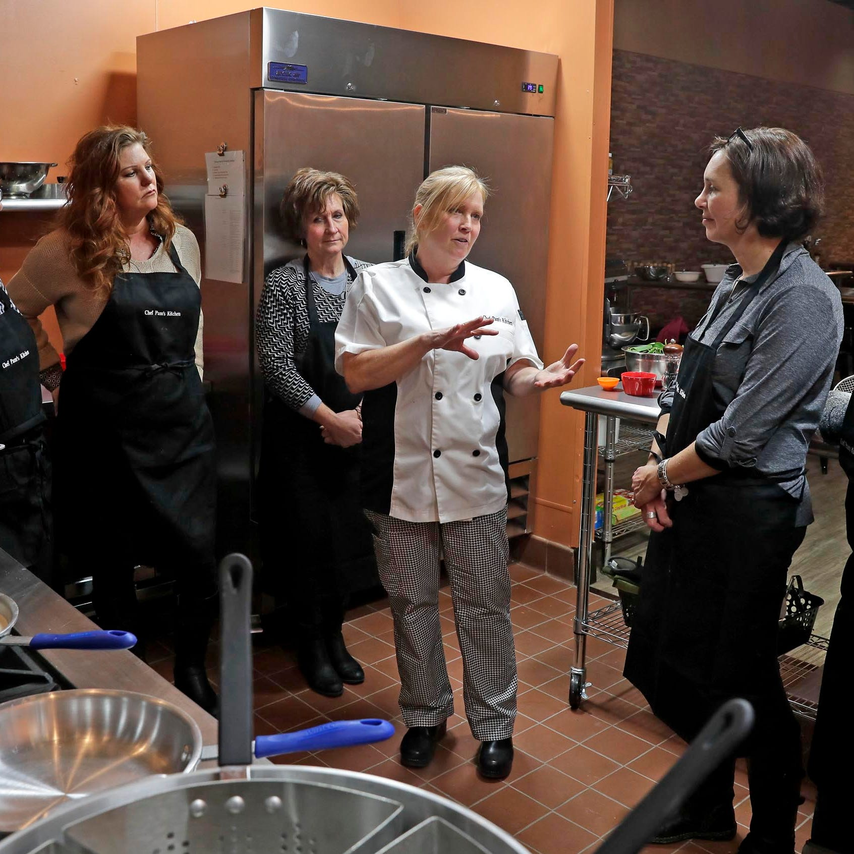 She was a Navy nurse overseas, dining with an 'Italian Mom.' Now she runs a cooking school