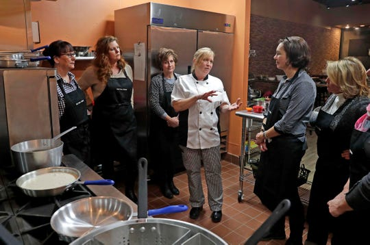 Pam Dennis gives instructions to her students.