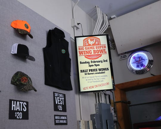 A Leff's Lucky Town sign promotes the Wauwatosa bar's Super Bowl party.