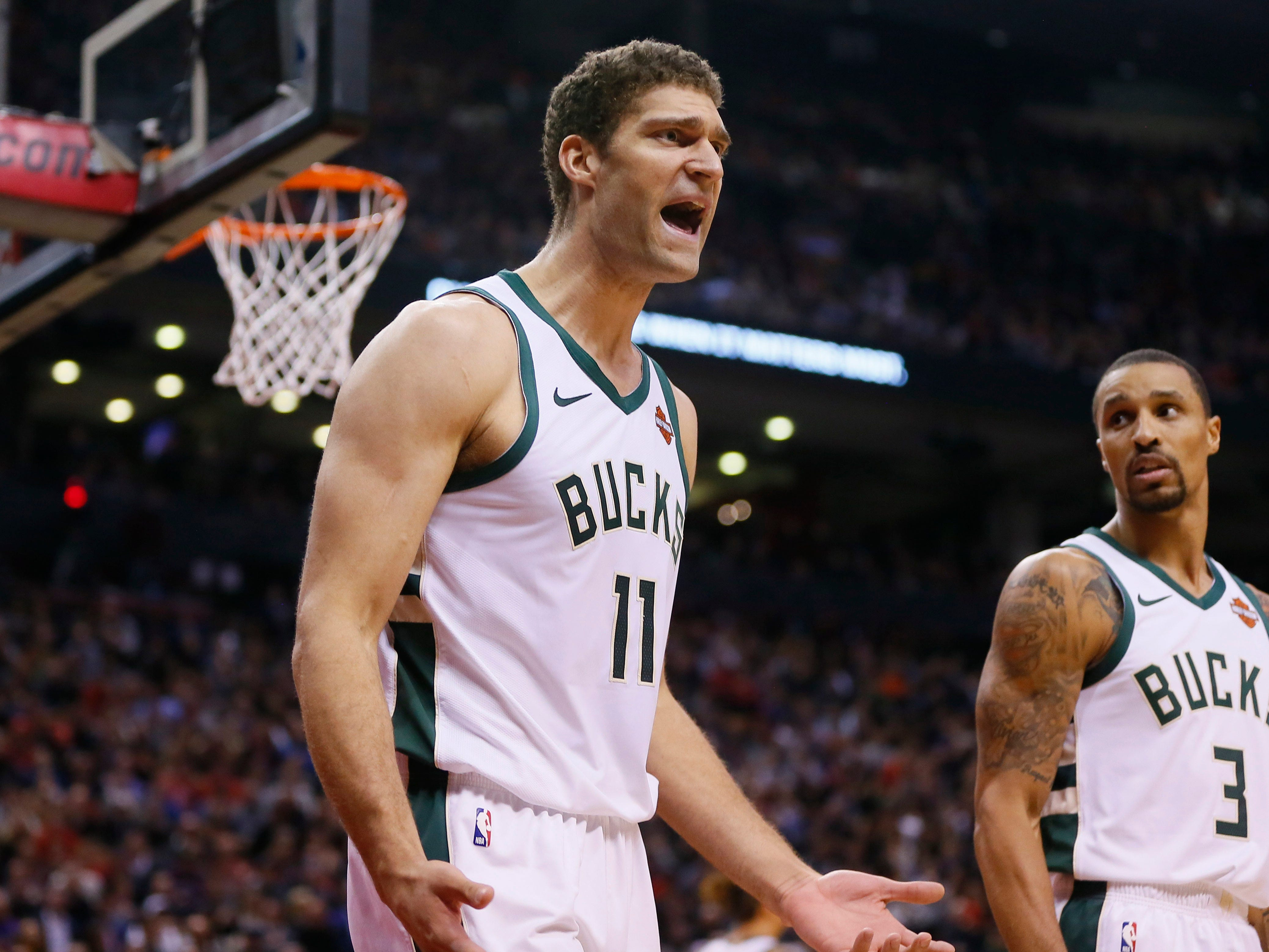 Bucks center Brook Lopez can't believe that he was whistled for a foul during the game against the Raptors on Thursday night.