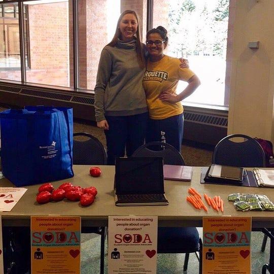 Founding members Jen (left) and Viabhavi (right) tabling for SODA at Marquette University