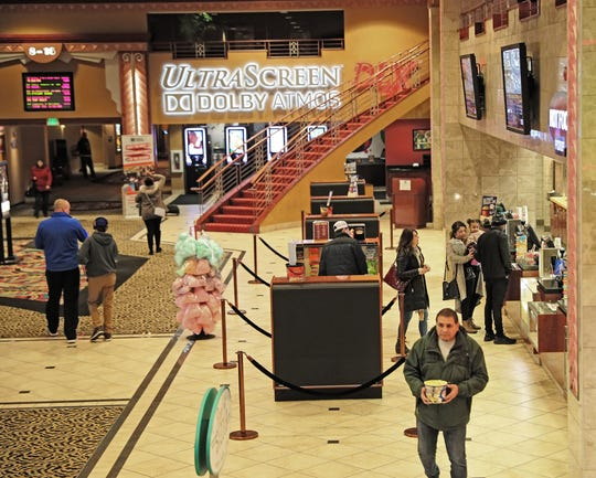 People buy concessions at the Marcus Majestic theater. Marcus Corp. has completed its acquisition of Movie Tavern, giving it movie theaters in nine new states.