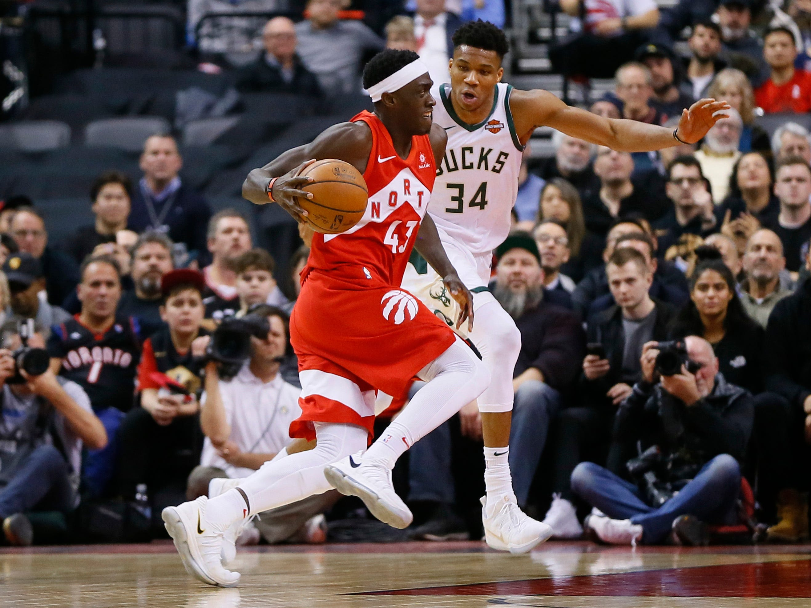 Raptors forward Pascal Siakam, driving against Gianis Antetokounmpo during the second half, was a thorn in the Bucks' side on Thursday night with a game-high 28 points.