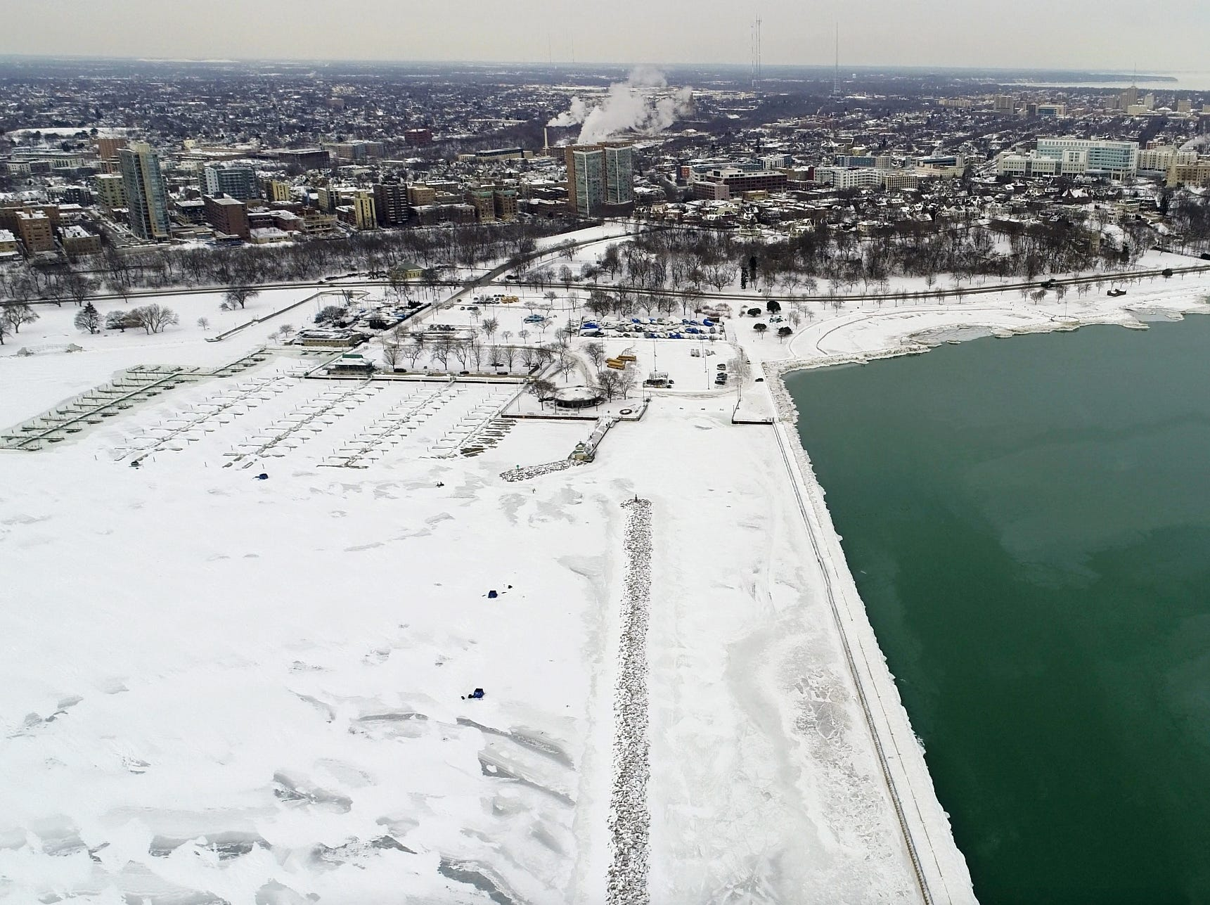 McKinley Marina is locked in with ice while open water remains to the north on Milwaukee's lakefront Friday.