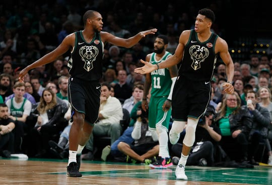 Dec 21, 2018; Boston, MA, USA; Milwaukee Bucks forward Giannis Antetokounmpo (34) reacts with forward Khris Middleton (22) during the second quarter against the Boston Celtics at TD Garden. Milwaukee defeated the Celtics 120-107. Mandatory Credit: David Butler II-USA TODAY Sports